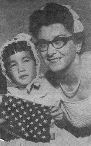 Ramona and mom holding flag